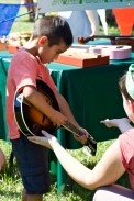 Making music at the Instrument Petting Zoo.