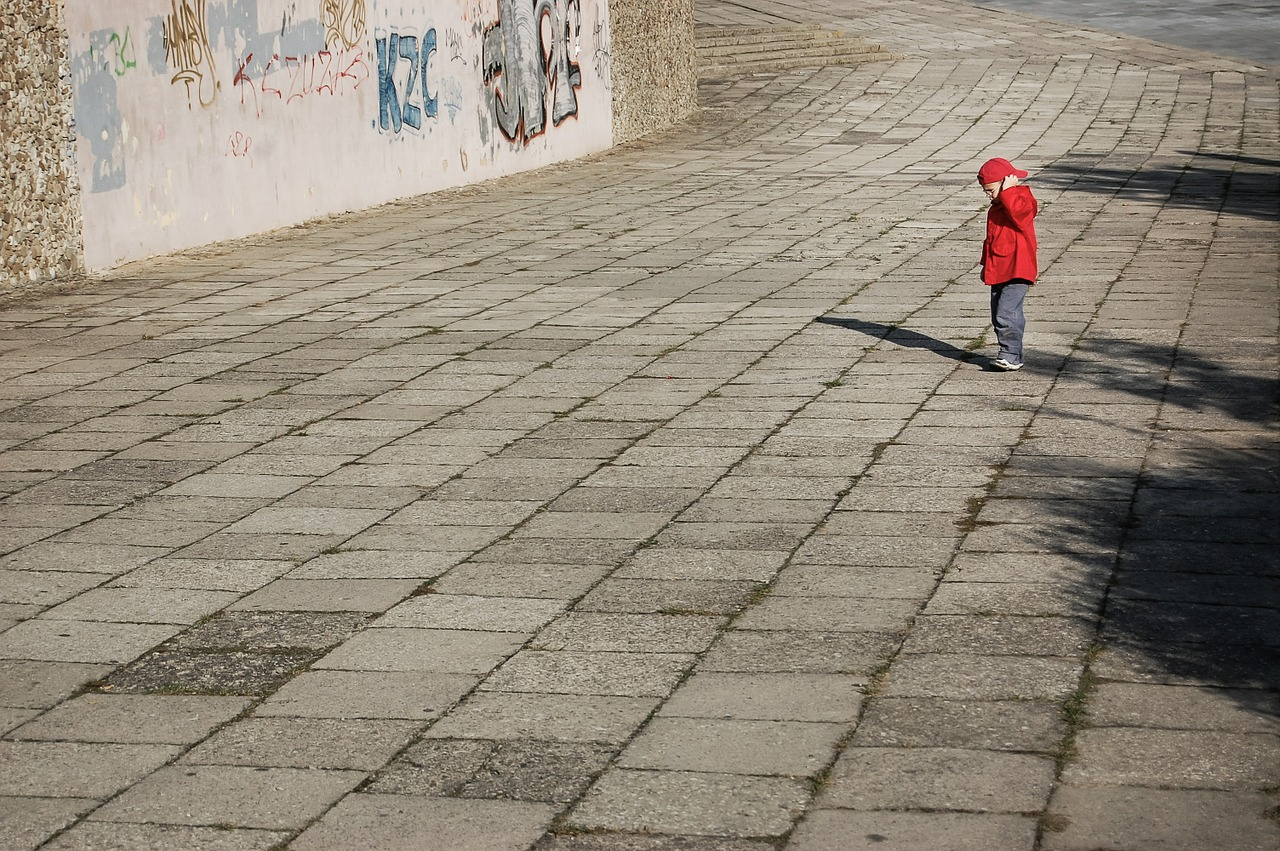 Chatsifieds lonely child in red jacket