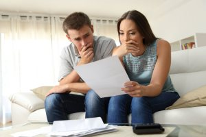a couple thinking and holding a paper   Chattanooga Home Inspector   Insurance Chattanooga