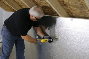 contractor works on the attic | Chattanooga Home Inspector | energy bills Chattanooga