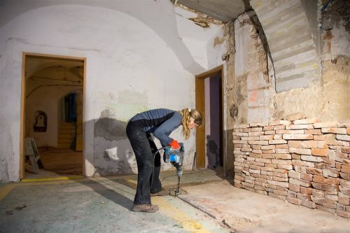 woman drilling the basement floor | Chattanooga Home Inspector | Bathroom in the basement Chattanooga
