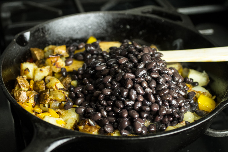 These black bean burritos with potatoes are a simple, one-skillet vegetarian dinner that you can hold in one hand-perfect for breakfast or lunch, too! | recipe from Chattavore.com