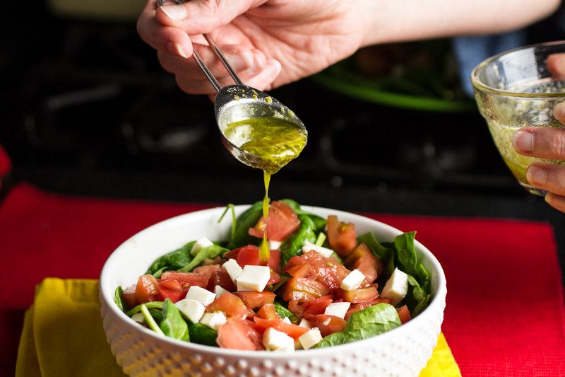 Spinach caprese salad showcases all the flavor of perfect summer tomatoes with a delicious pesto vinaigrette! | chattavore.com