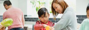 Adult teaching child