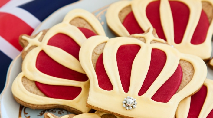 Royal wedding cookies on a plate with the British flag in the background