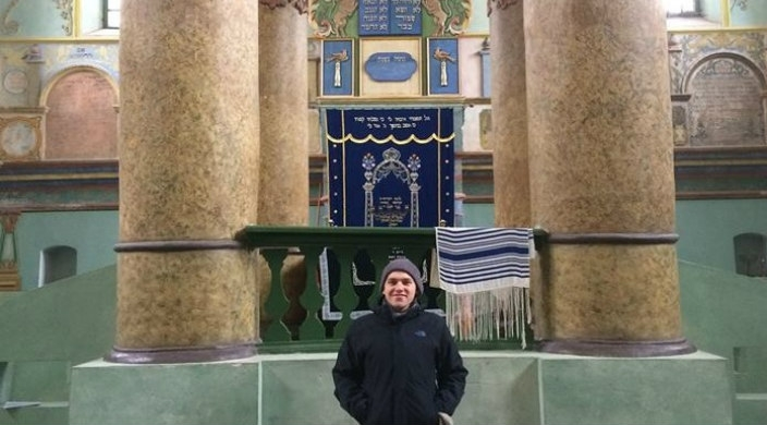 The author standing in front of a synagogue in Poland
