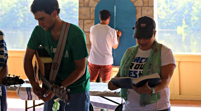 The author and a songleader lead morning services from the front of an outdoor bimah