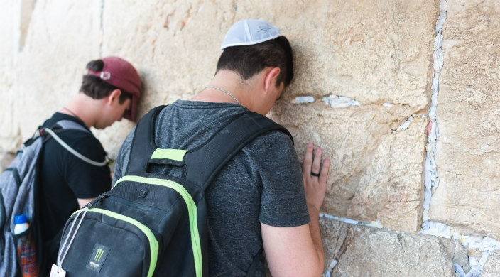 Two NFTY participants praying at the Kotel