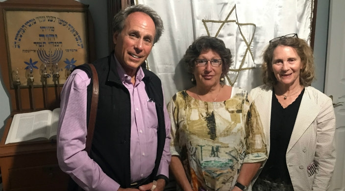 The author, Phyllis Dorey, with two others in front of the closed ark on erev Rosh HaShanah in Lisbon, Portugal