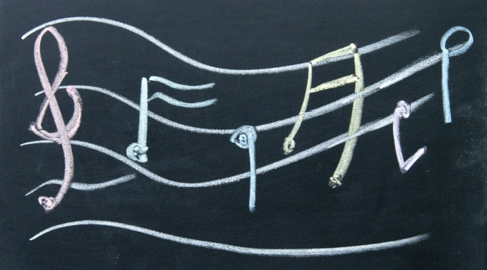 G-clef and musical notes written in chalk on a blackboard