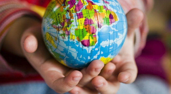 Childs hands holding a small globe