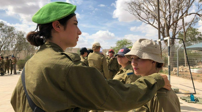 Women in Israeli military with arm on shoulder of URJ Heller High student