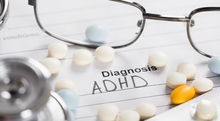 Doctors coat with a diagnosis pad reading ADHD