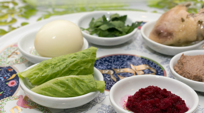 Close up image of a colorful seder plate with ritual elements upon it