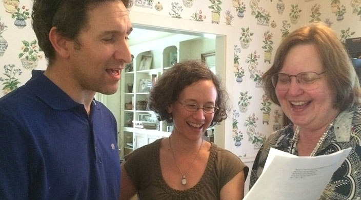 Three members of the author's family singing a song from one of her plays at their seder
