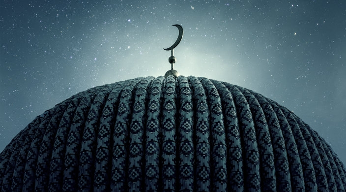 Dome of a mosque with crescent symbol atop the roof; stars in the sky
