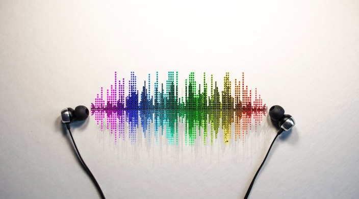 Rainbow colored sound waves between two earbuds