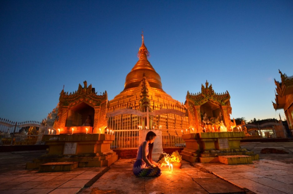 The beautiful woman Myanmar in Kuthodaw Pagoda on after sunset blue hour, treaditional culture myanmar,Mandalay Myanmar