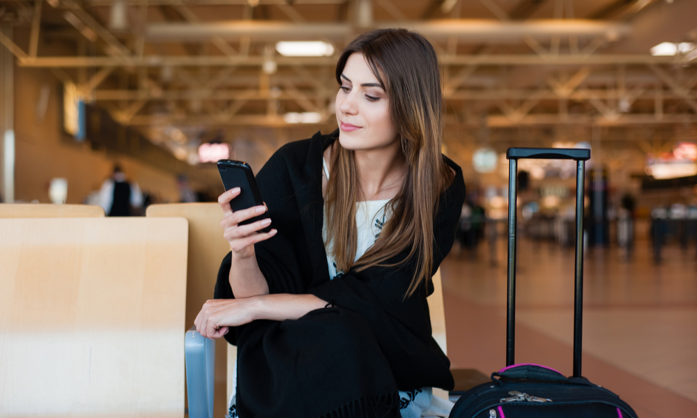 Woman using the benefits of online check-in