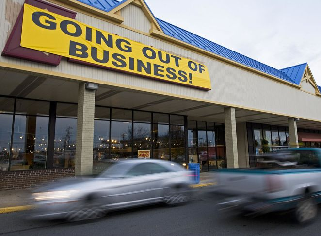 "A furniture store posts a ""Going Out of Business"" sign"