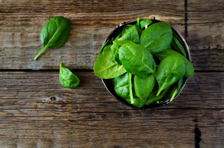 fresh spinach leaves in a bowl