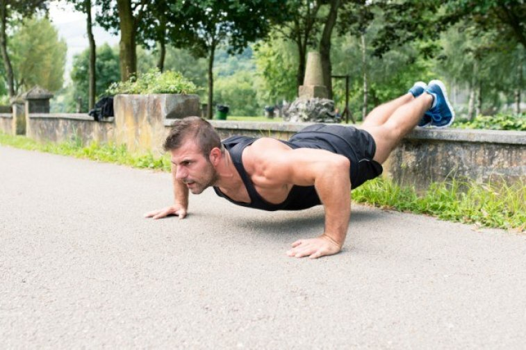 man working out in a park