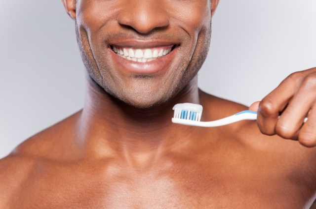 man getting ready to brush his teeth