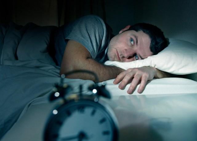man trying to fall asleep at night