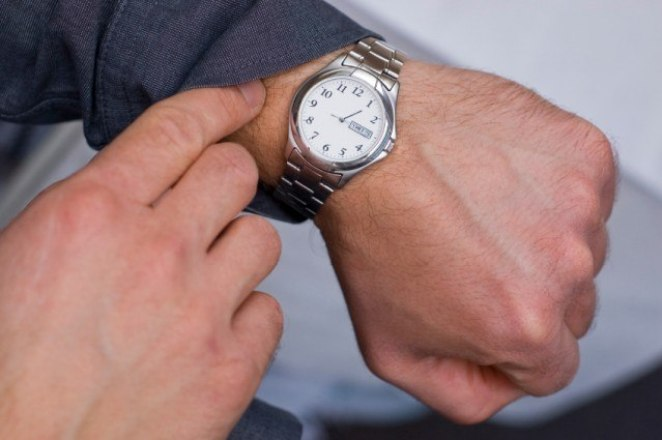 Man looking at watch