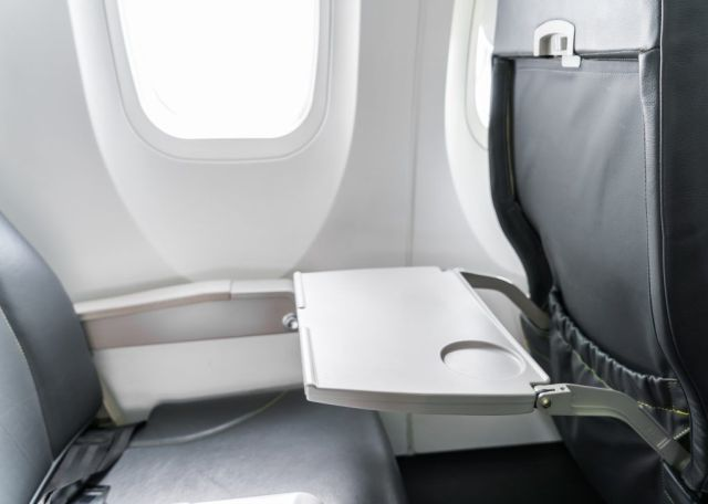 Tray on back of airplane seat