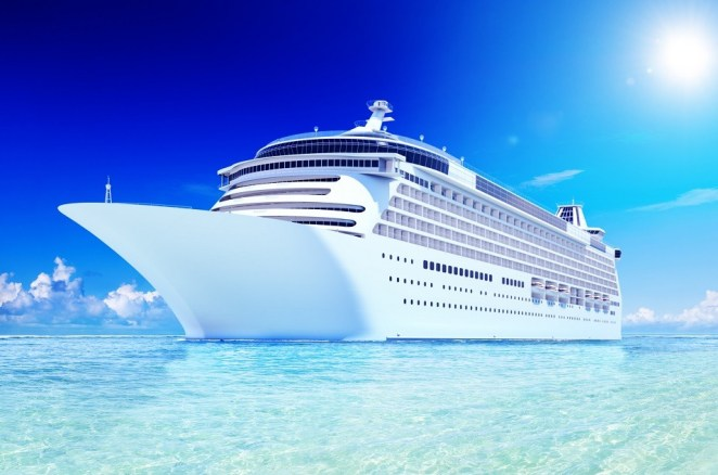 A large white cruise ship sitting crystal blue water