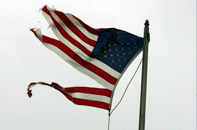 A tattered American flag signifies the broken American Dream