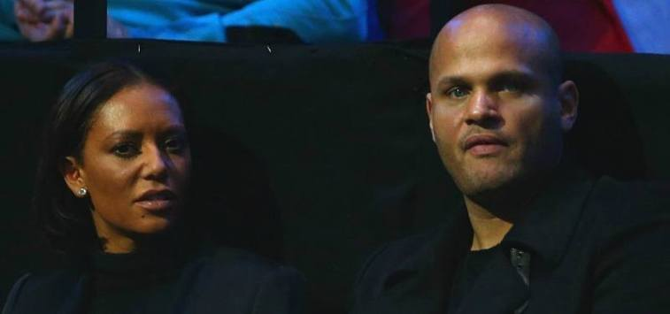 Mel B and Stephen Belafonte are sitting down in the audience of a competition.