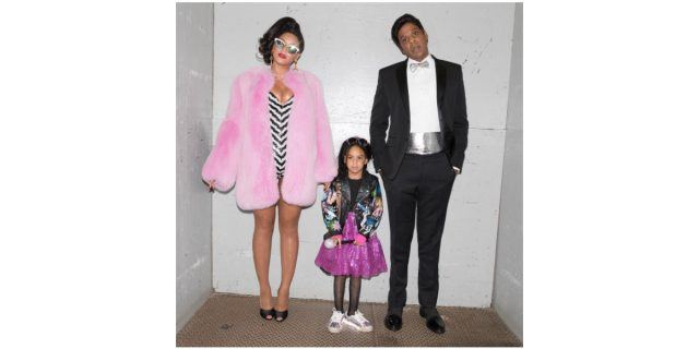 Beyonce, Blue Ivy and Jay-Z pose for a photo, dressed in their Barbie Halloween costumes.