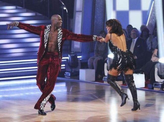 Cheryl and Chad dance on the floor during a performance.