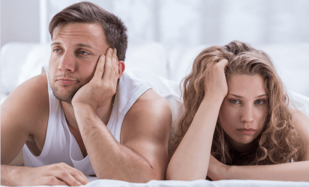 couple looking bored in bed