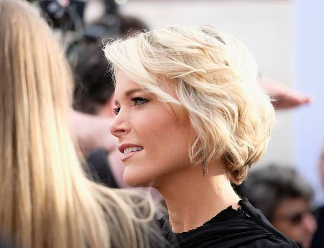 Megyn Kelly looks ahead while wearing a black shirt