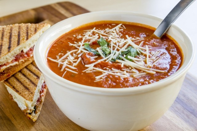 tomato and basil soup sprinkled with parmesan cheese