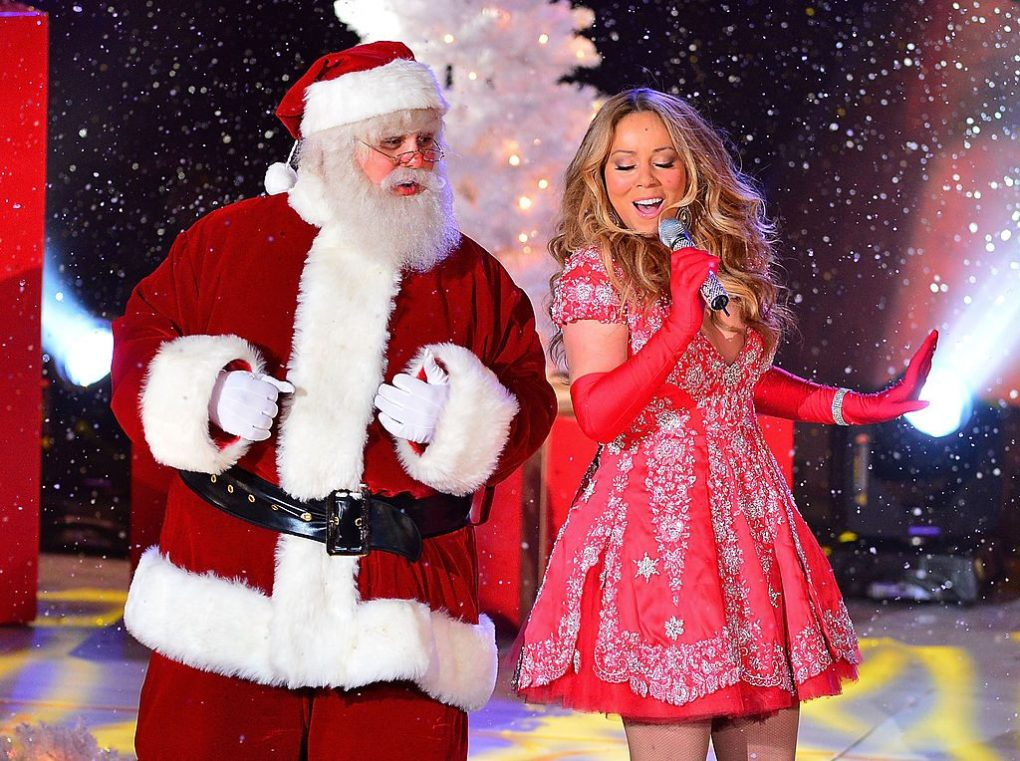 Santa Claus and Mariah Carey perform during a pre-taped performance for NBC's Christmas tree lighting at Rockefeller Center on November 27, 2012 | James Devaney/WireImage