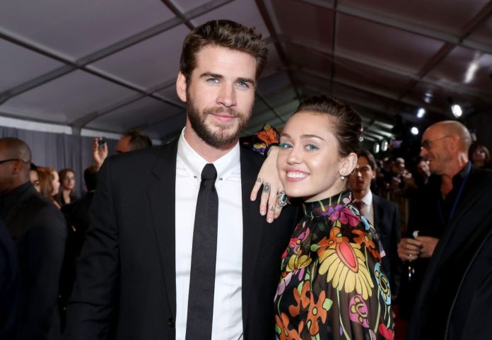 Liam Hemsworth and Miley Cyrus at a film premiere.