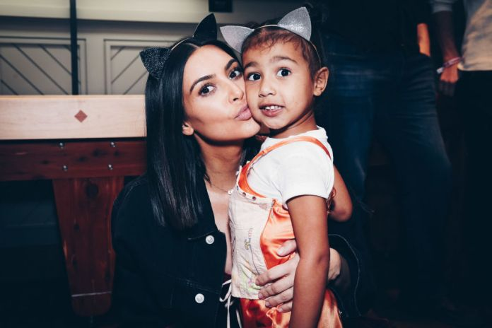 Kim Kardashian West and 1/4 of his children North West