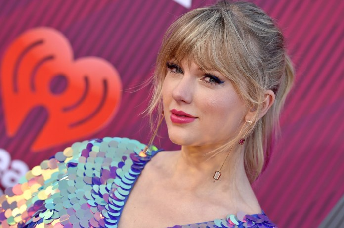 Taylor Swift will receive the 2019 iHeartRadio Music Awards broadcast live on FOX at Microsoft Theater on March 14, 2019 in Los Angeles, California.