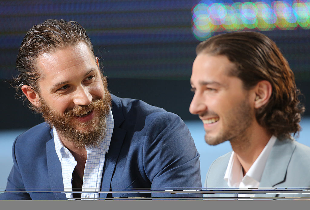 (LR) Tom Hardy and Shia LaBeouf smiling