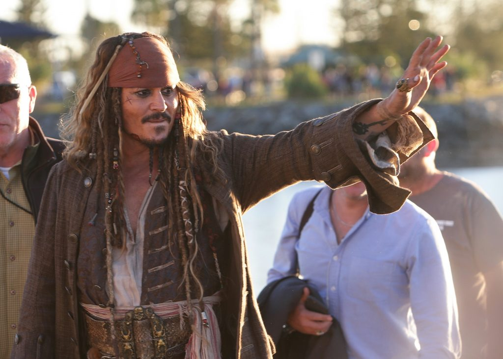 Johnny Depp welcomes fans in a suit like Jack Sparrow