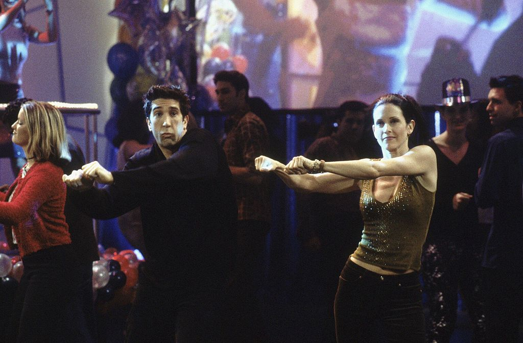 "Friends throw David Schwimmer as Ross Geller, Courteney Cox as Monica Geller dancing in the season 6 program ""The One With The Routine"""