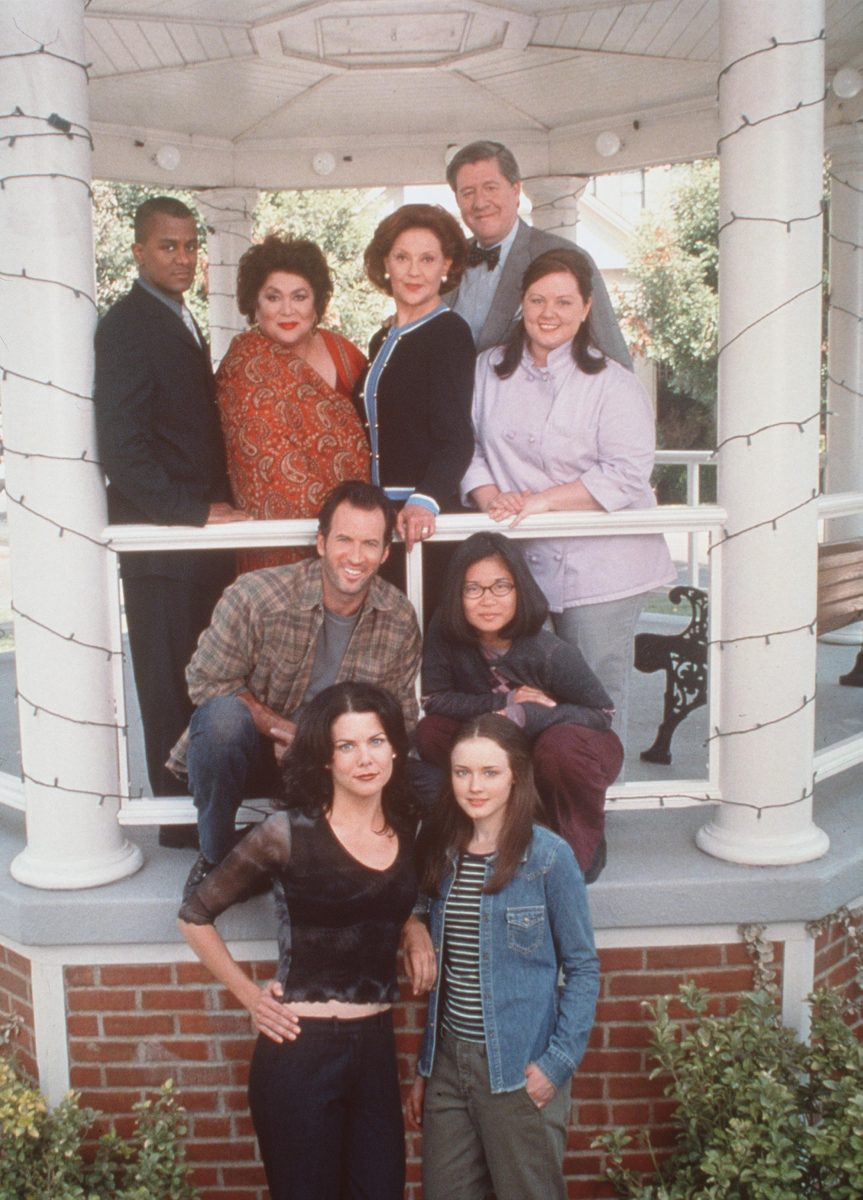 The team of 'Gilmore Girls' are standing for a promotional photo