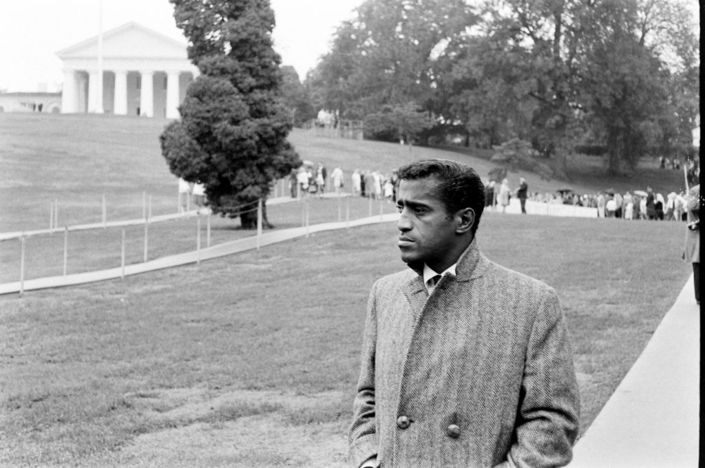 Sammy Davis Jr. visits the grave of John F. Kennedy