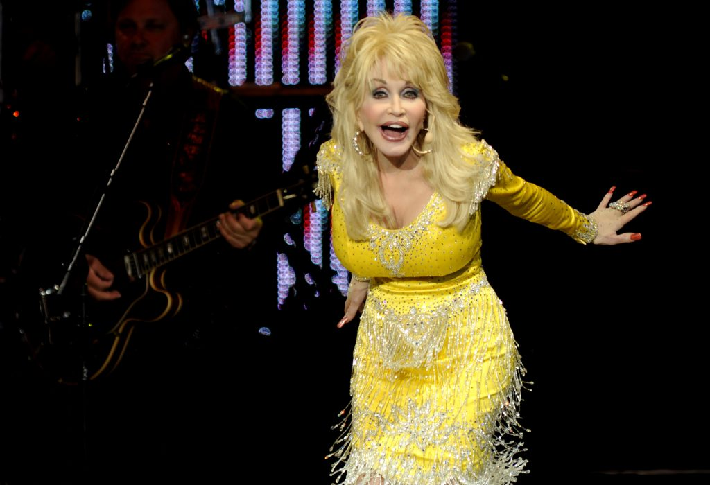 Dolly Parton in a yellow dress