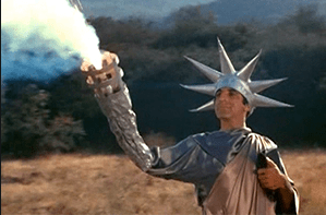 Jamie Farr as Max Klinger wearing the Statue of Liberty gown