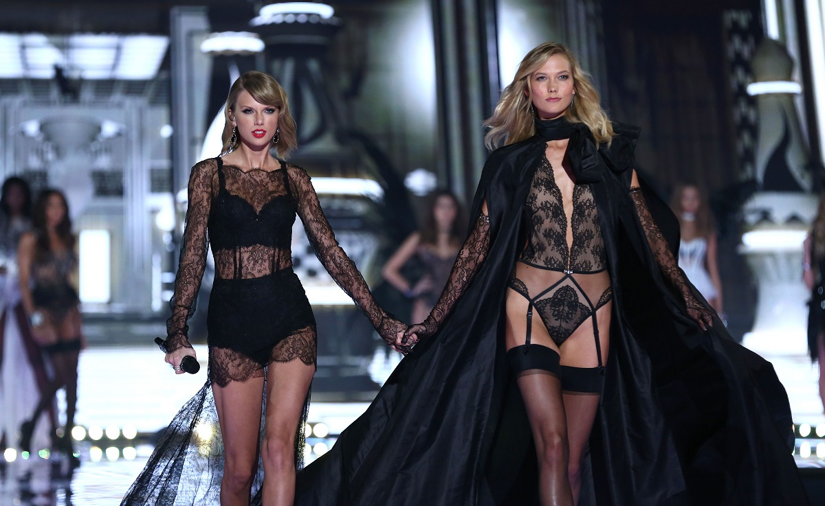 Taylor Swift and Karlie Kloss walk the runway at Victoria's Secret's annual fashion show on December 2, 2014 in London, England.